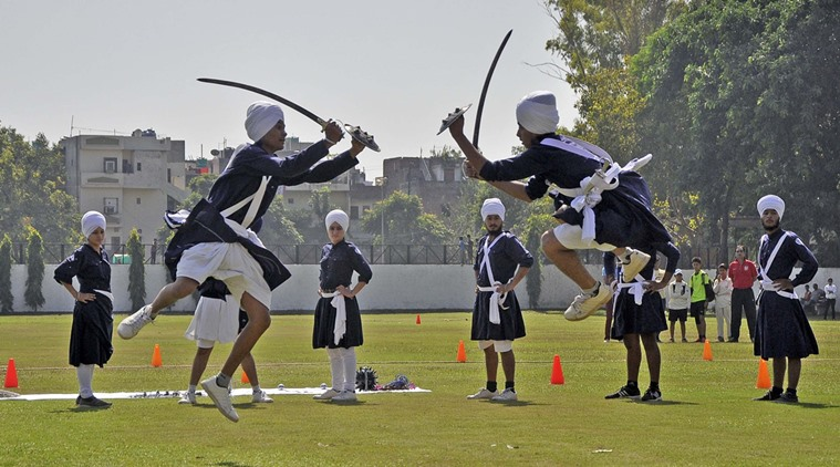 Students performing Gatka during the opening of 61st National School Games 2015 – 16 (Cricket under 19 girls) organised by the Department of Education UT at Government Model School in Sector 26 of Chandigarh on Thursday, October 08 2015. Express Photo by Sahil Walia